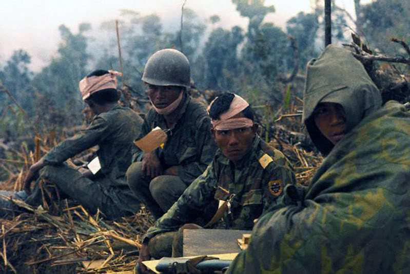 "15 Feb 1971, Phu Loc, South Vietnam --- Wounded Vietnamese Rangers await medivac chopper at Landing Zone ""Phu Loc"" about 1 km from the Laotian border. --- Image by © Bettmann/CORBIS"