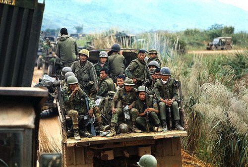 07 Feb 1971, Near Khe Sanh, South Vietnam --- Vietnamese soldiers travel in personnel carriers, part of a procession which also includes American troops, during Operation Dewey Canyon II/Lam Son 719, which is aimed to reopen and secure Route 9 and reoccupy Khe Sanh as a forward supply base. --- Image by © Bettmann/CORBIS